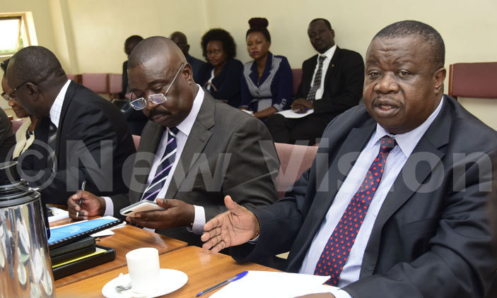 Minister for Justice Kahinda Otafiire(R) and deputy attorney general, Mwesigwa Rukutana appearing before the legal and parliamentary affairs committee on April 11, 2017.